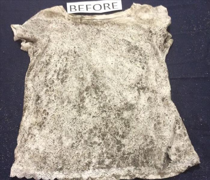 White lace shirt covered in soot