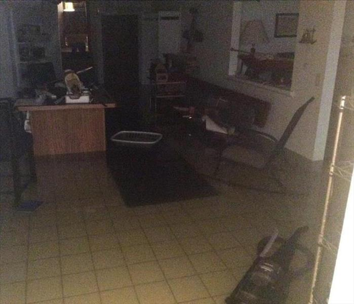 Flooded Basement in Lawrence, KS Before