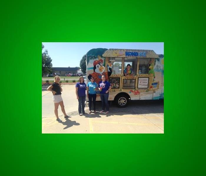 4 of our clients standing by the Kona Ice truck