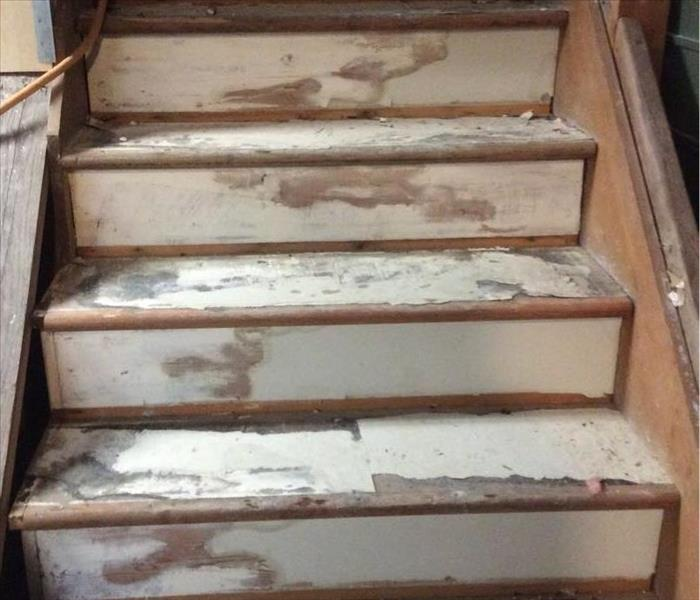 Wood stairs suffering from the effects of fire damage