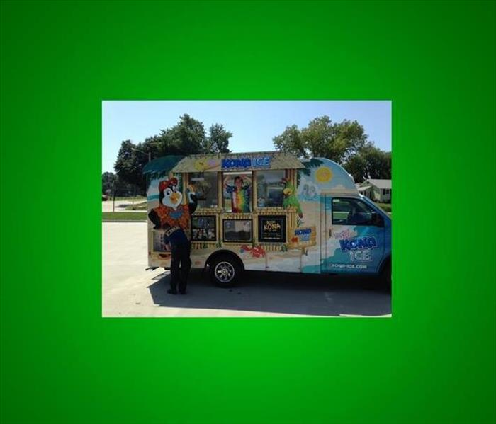 The Kona Ice truck parked in front of a local agents office